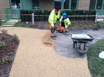 Resin bound gravel being laid on block H at Kidbrooke Park